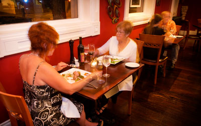 Two women enjoying dinner at Brownstone Restaurant.